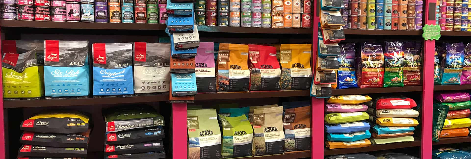 wall of pet food at Woof Gang Bakery